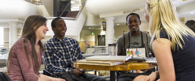UCF Students sittng at a table