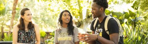 Three students, University of Central Florida, interacting