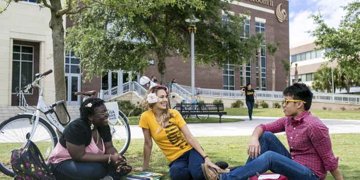 Unviersity of Central Florida, UCF, three students sitting on the grass