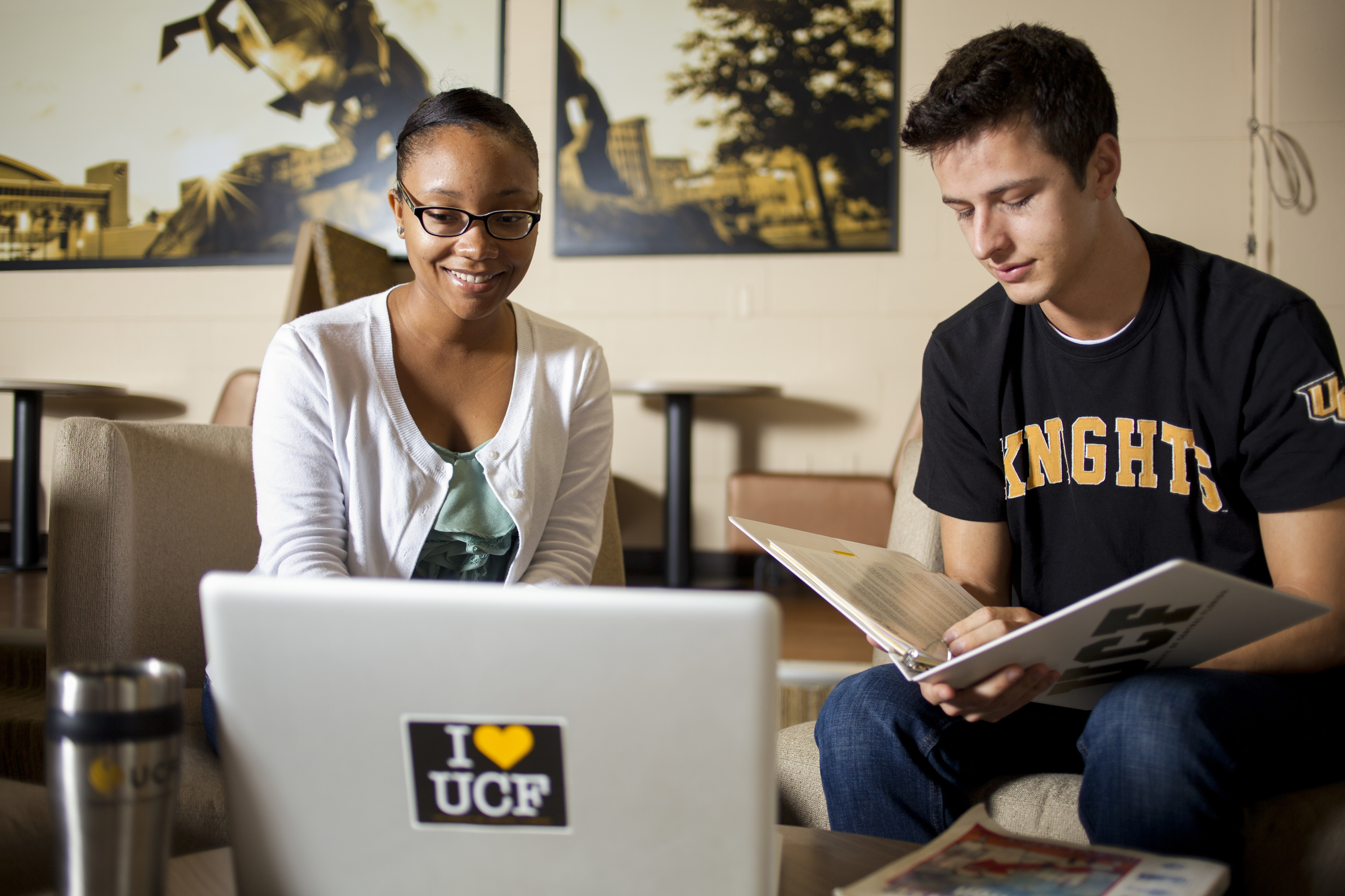 Two students talking in Farrell Commons
